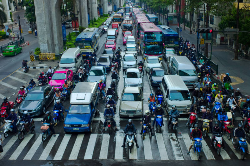Motorcyclists lane split in Bangkok, Thailand. Lane splitting is common practice in much of Asia and Europe.