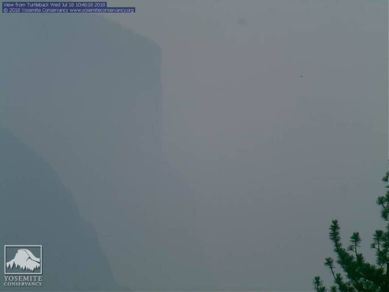 A view of El Capitan in Yosemite National Park obscured by smoke from the Ferguson Fire on July 18, 2018.