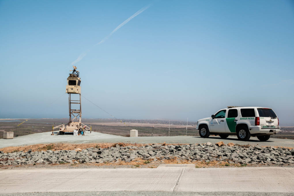 "A Border Patrol SUV looks over the U.S.-Mexico Border in the ""Bunker Hill"" district near Tijuana, Mexico."