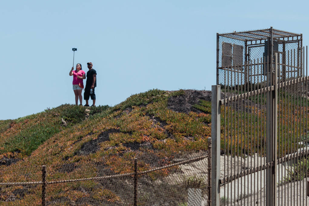 People take a selfie outside of Friendship Park in San Ysidro, Calif. Friendship Park is open on Saturdays and Sundays for four hours. Friends and family members are able to visit one another and speak through a metal fence.
