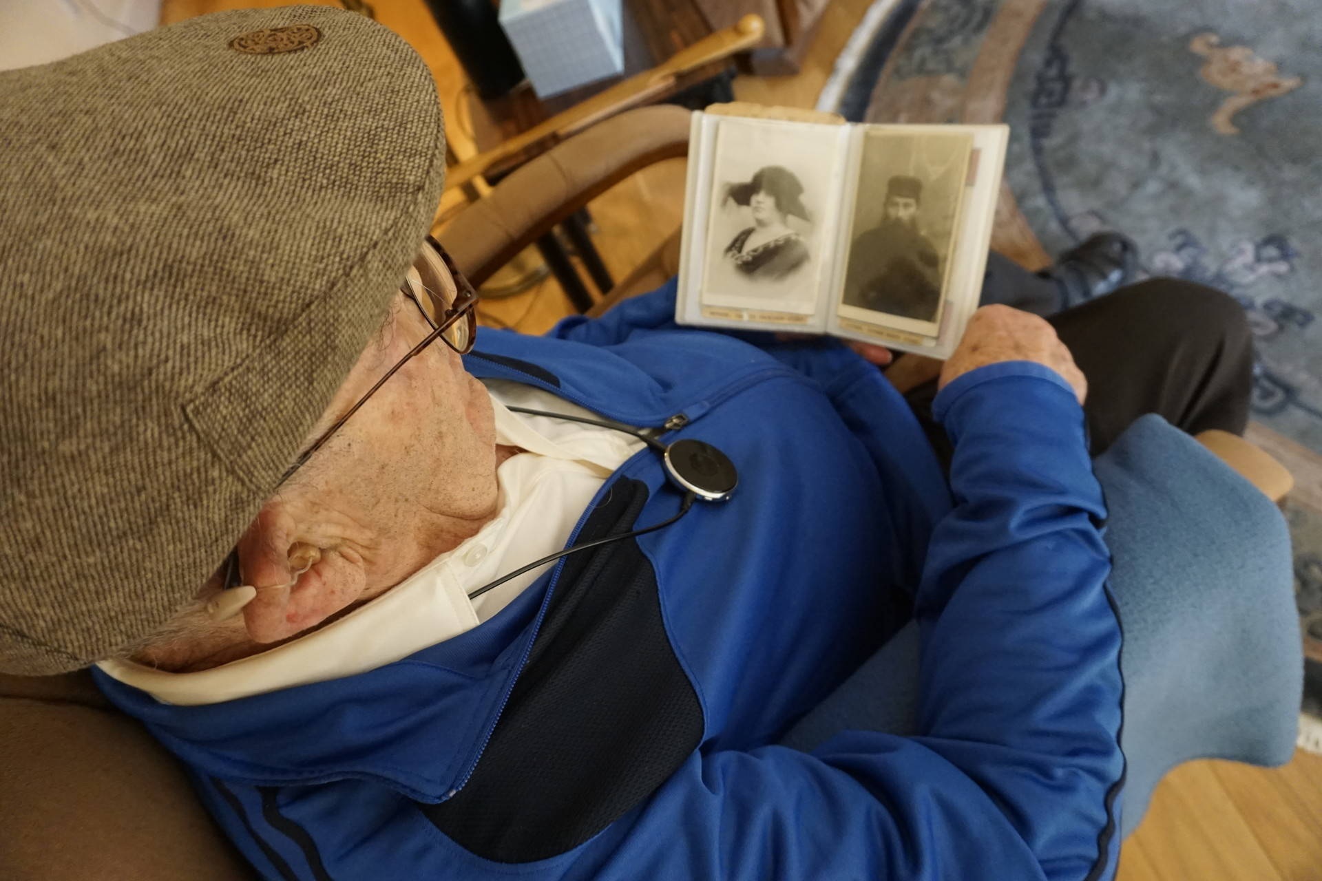 Ben Stern looks at the few remaining photographs of his parents, saved by the only one of his siblings to survive the Holocaust. Sasha Khokha/KQED