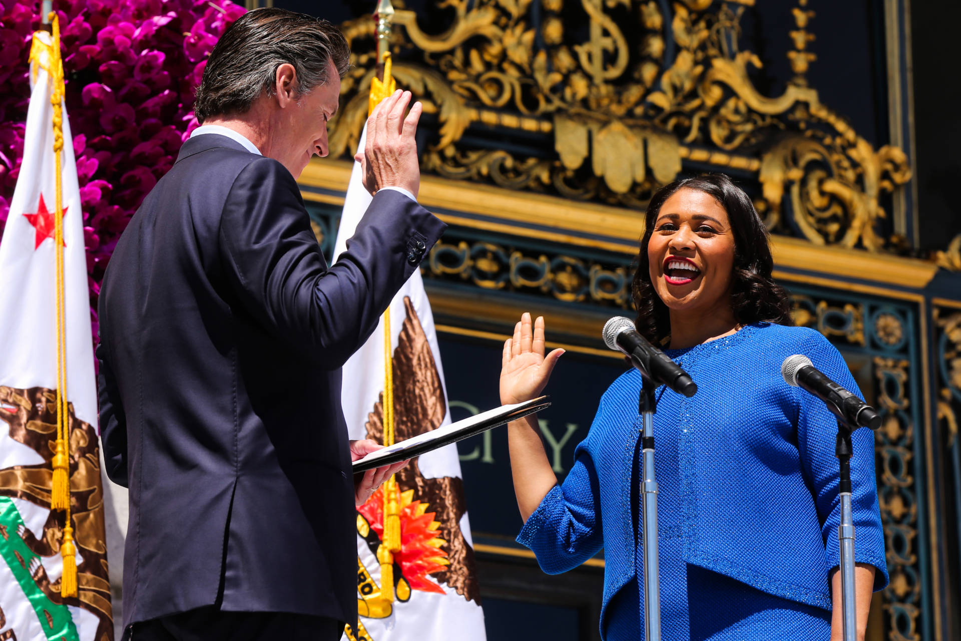 Mayor London Breed takes the oath of office from Lt. Gov. Gavin Newsom during the inauguration ceremony outside City Hall in San Francisco, California, on Wednesday, July 11, 2018. San Francisco Chronicle Pool Photo