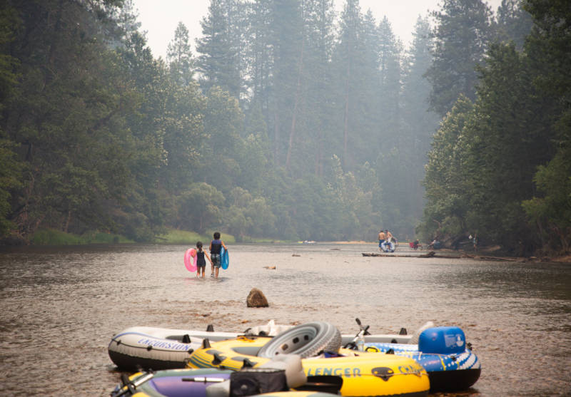 Park-goers raft in the Merced River in Yosemite National Park over the weekend. Decreased air quality due to smoke from the Ferguson Fire and a Highway 140 shutdown from El Portal to the park's West Gate led to much smaller crowd sizes.