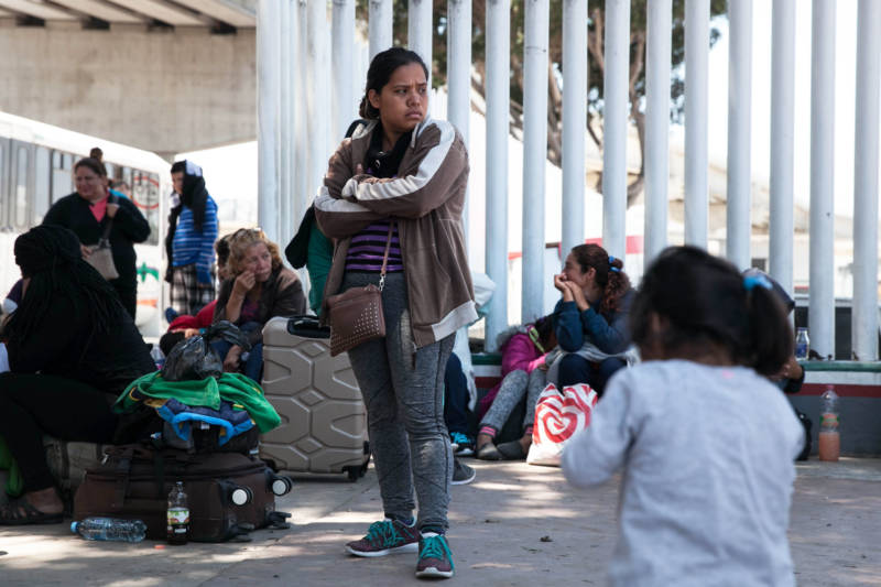Women, most of them mothers, wait on the Mexican side of the border in the hopes of getting on a waitlist for an asylum interview.