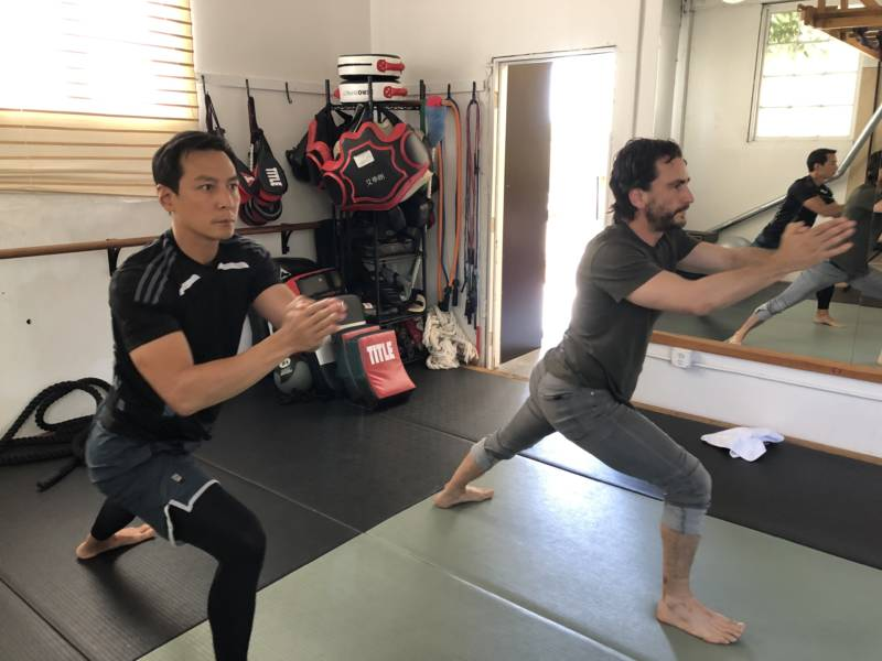 Daniel Wu and his trainer, Matt Lucas, work out at The Open Matt, a dojo in Oakland.