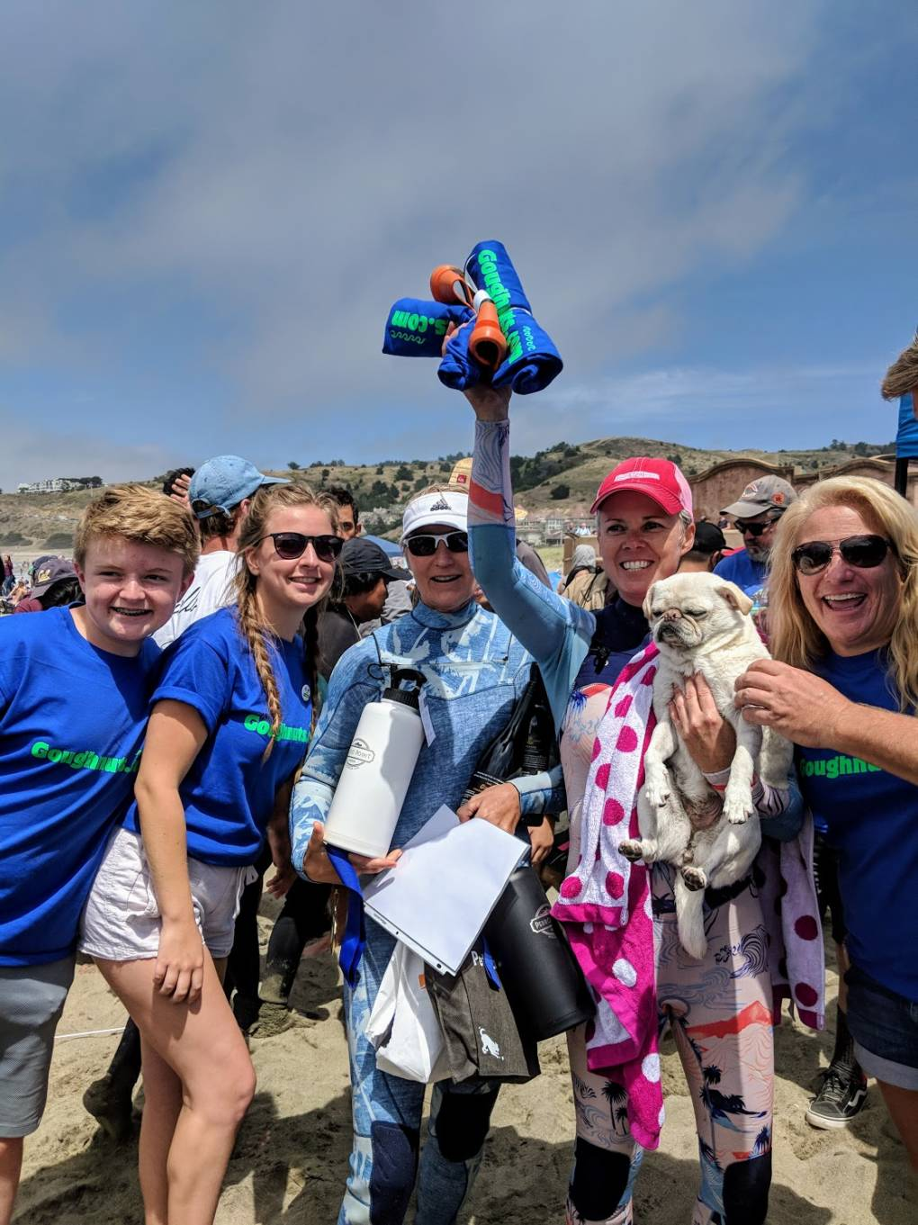 """Top Dog"" Gidget and her owners Fiona Kempin and Alecia Nelson pose for pictures after her big win. Gidget does tricks like 360 turns and 'walking the board' during her surf events."