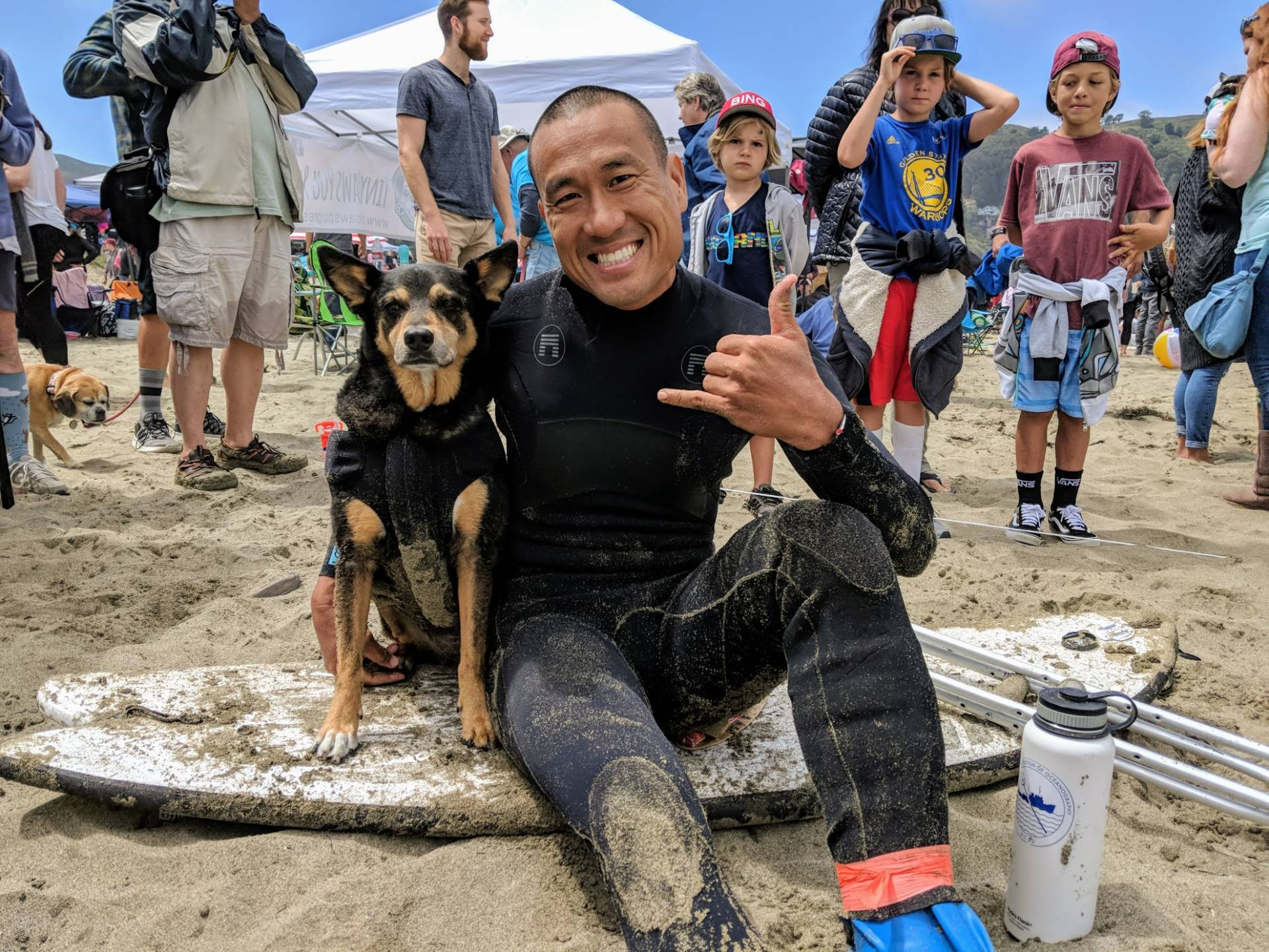 """Michael Uy and his dog Abbie Girl are here from Santa Monica. Abbie is the returning champ and also has the Guinness World Record for longest wave surfed by a dog - a total of 107 meters. """"You can really tell the bond you have with your dog when you go out surfing together."""""""