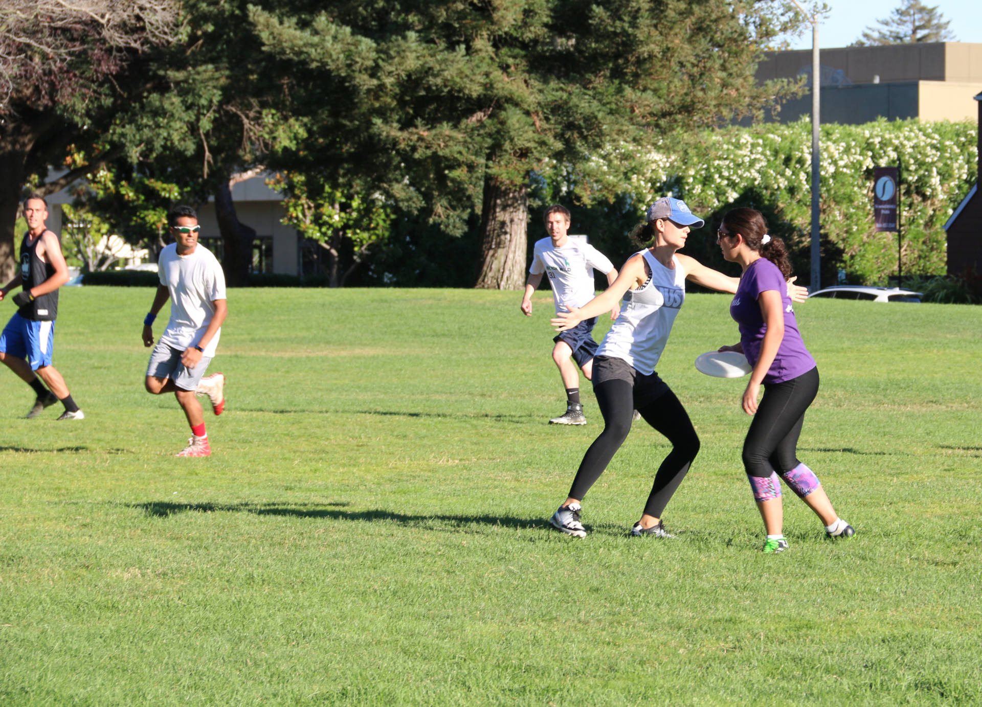 Afifa Tawil is an organizer of pickup ultimate games in the South Bay. Here she eyes opportunities to pass the Frisbee.  Olivia Allen-Price/KQED