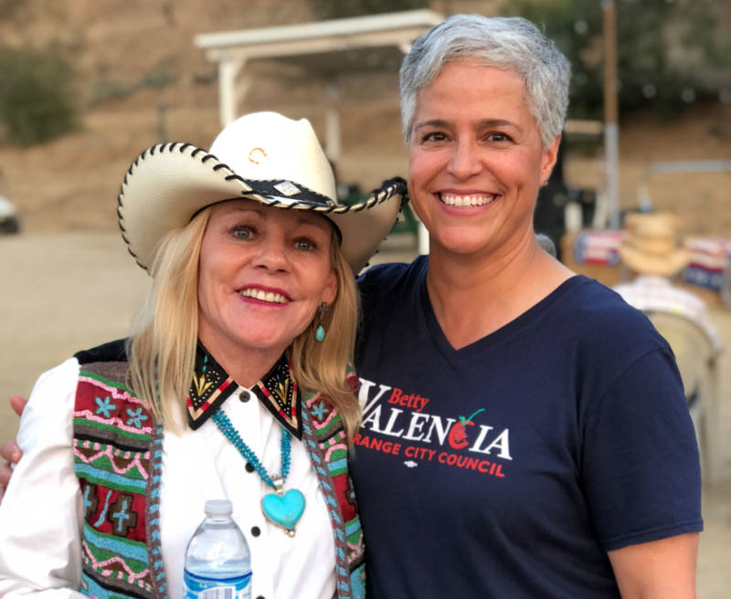 Betty Valencia (right) with a supporter in the city of Orange, California.