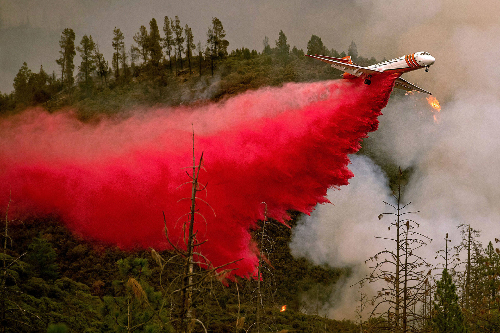 An air tanker drops retardant while battling the Ferguson Fire near Yosemite National Park on July 21. The fire is now burning within the park boundary. NOAH BERGER/AFP/Getty Images