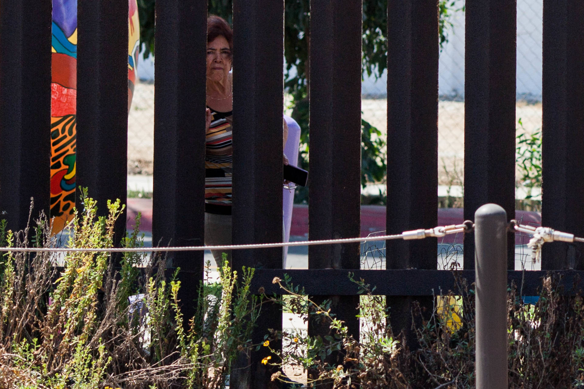 A woman looks through the border fence from Friendship Park in Tijuana.