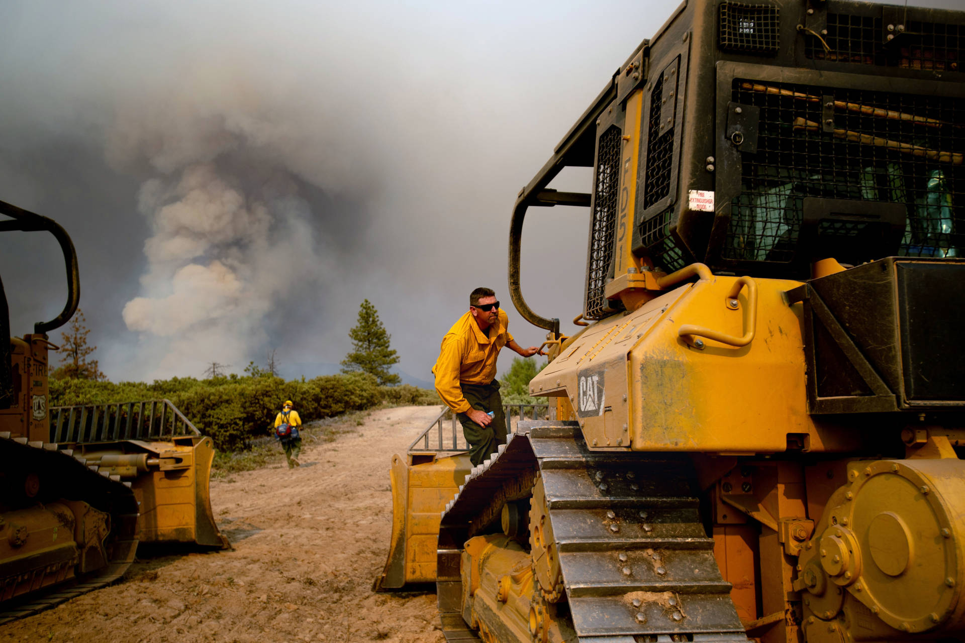 A dozer operator prepares to create a fire break while battling the Ferguson fire in the Stanislaus National Forest, near Yosemite National Park on July 21, 2018. NOAH BERGER/AFP/Getty Images