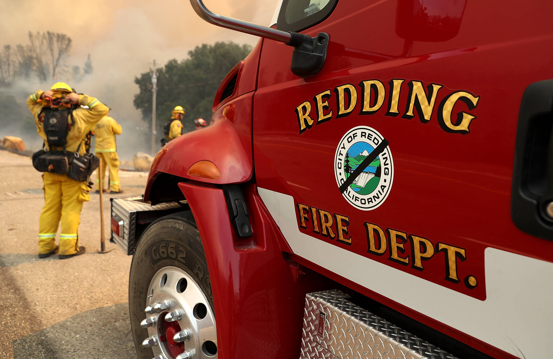 A black band is placed over the logo on a Redding Fire Department truck in honor of Jeremy Stoke, a fire prevention inspector with the agency who died July 26. Justin Sullivan/Getty Images