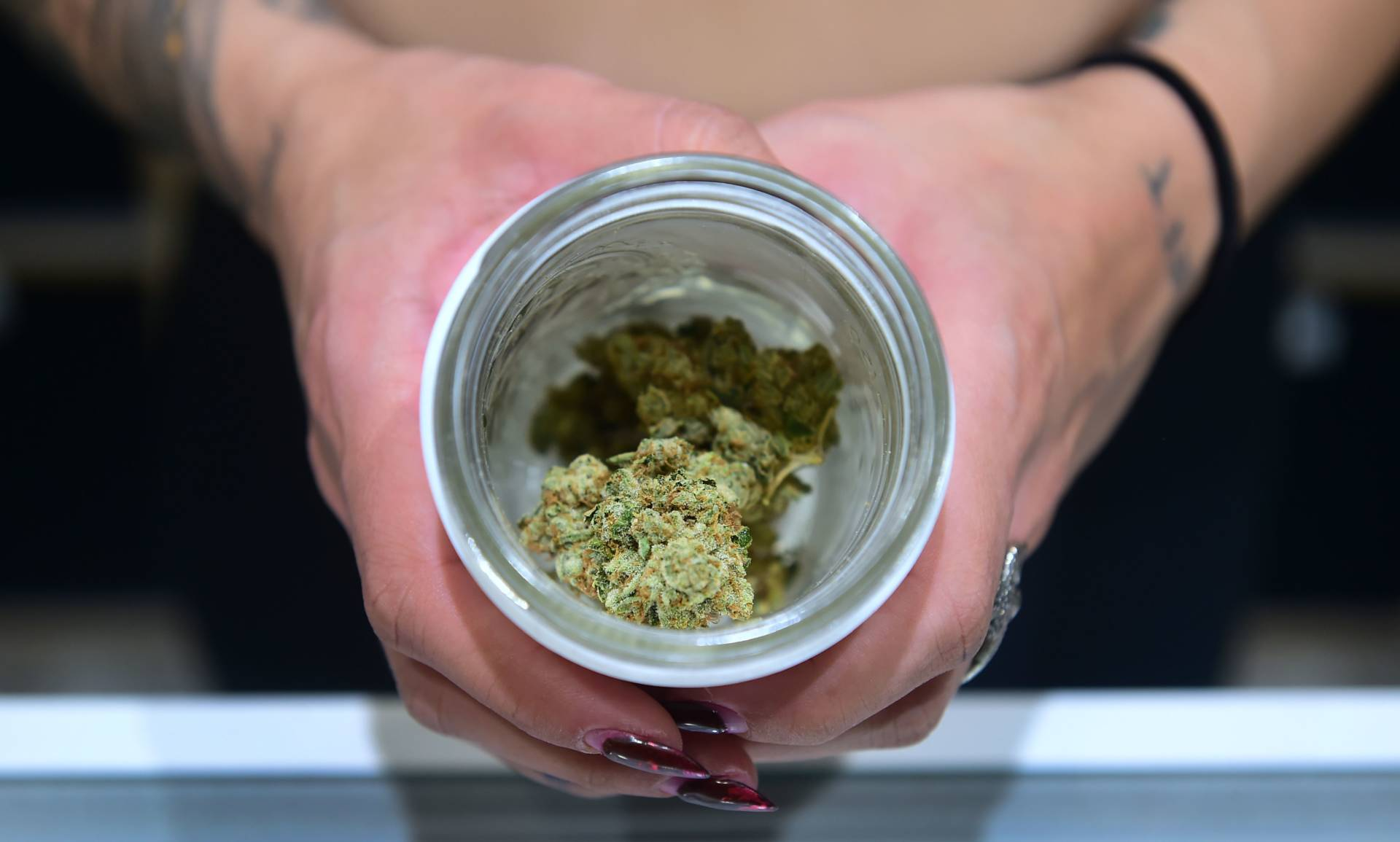 A jar of Insane OG, a strain of marijuana, is displayed at the opening of 'Dr. Greenthumb', the flagship medical and recreational marijuana dispensary opened today by B Real of Cypress Hill fame in Sylmar, California on August 15, 2018. FREDERIC J. BROWN/AFP/Getty Images