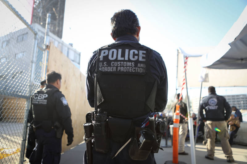 A U.S. Customs and Border Protection officer waits for pedestrians entering the United States at the San Ysidro port of entry on April 9, 2018 in San Ysidro, California.