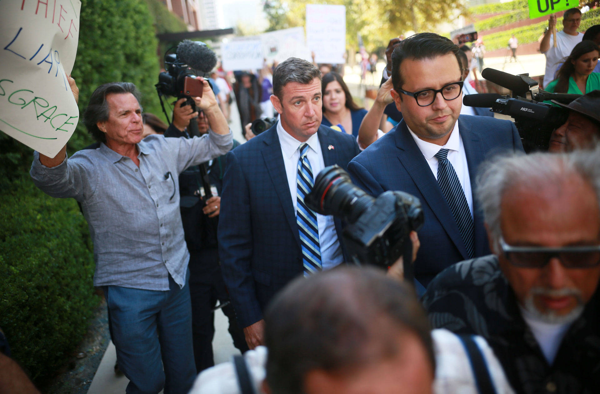 Congressman Duncan Hunter walks out of the San Diego federal courthouse after an arraignment hearing on Thursday, Aug. 23, 2018. Sandy Huffaker/Getty Images