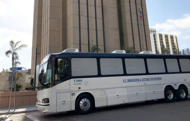 Migrants facing criminal charges for entering the U.S. illegally are bused to the Metropolitan Correctional Center in downtown San Diego.