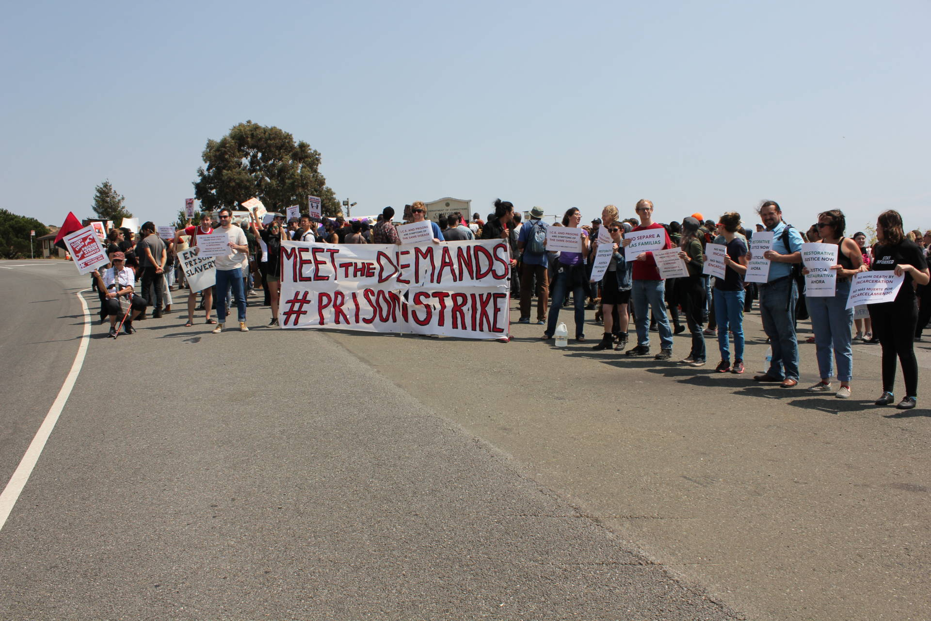 Protesters at San Quentin get approving honks from some passersby.  Sara Hossaini/KQED