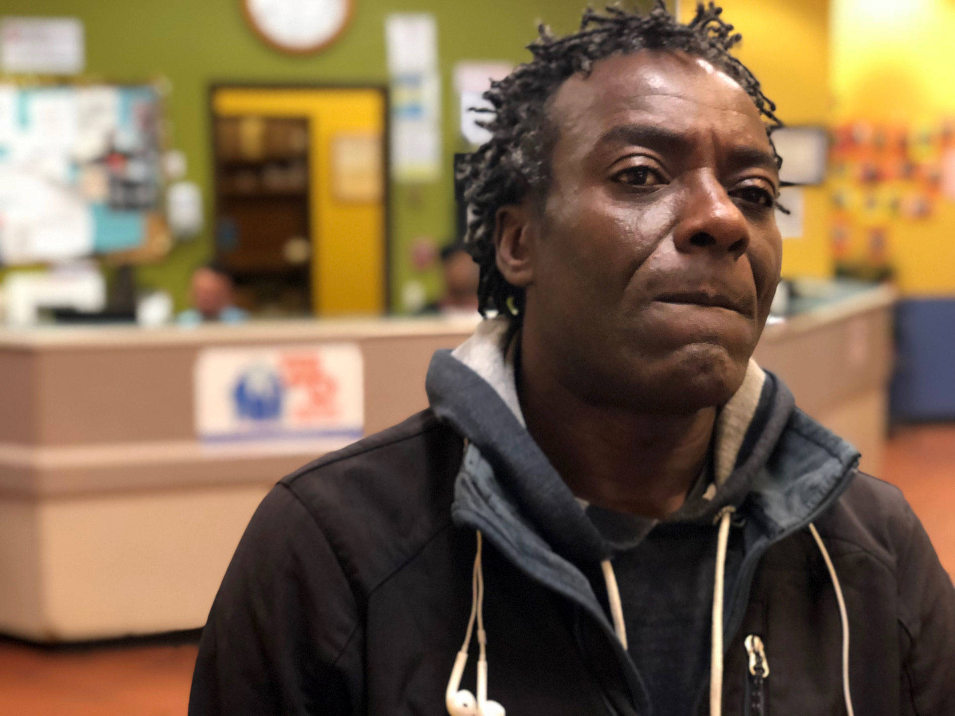 Sean Kayode, at the Next Door homeless shelter in San Francisco on July 26, 2018. Kayode is suing the city, saying he lost his means of food-delivery employment and his home when his car was impounded in March — for having too many parking tickets. David Gorn/CALmatters