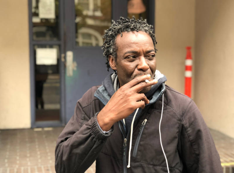Sean Kayode, outside the Next Door homeless shelter in San Francisco on July 26, 2018. Kayode is suing the city, saying he lost his means of food-delivery employment and his home when his car was impounded in March — for having too many parking tickets.