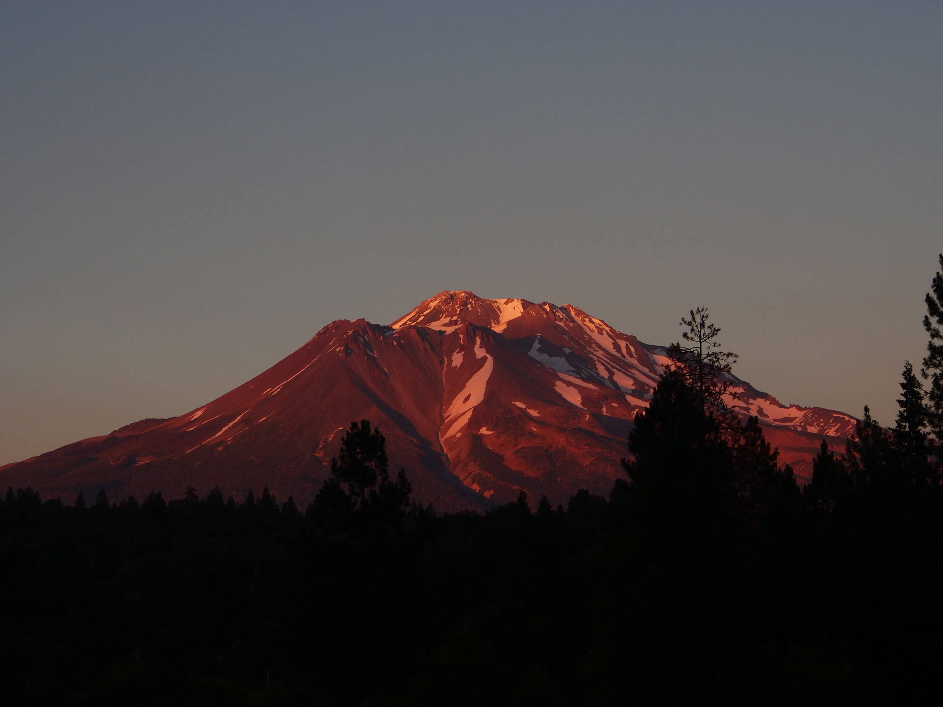 Mt. Shasta is California's highest volcano, and it towers above the surrounding landscape. Cat Schuknecht/KQED