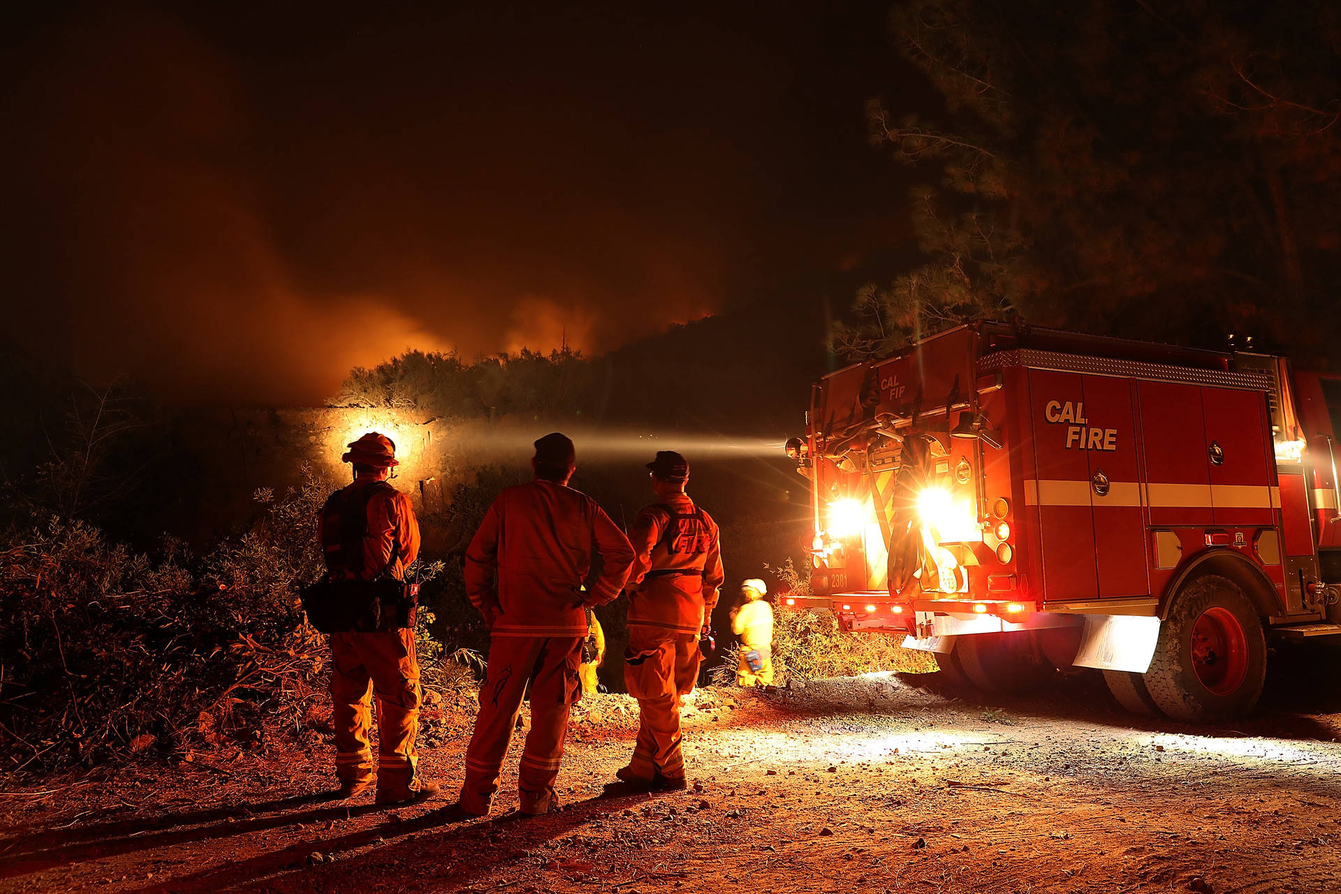 A Cal Fire crew monitors a firing operation while battling the Mendocino Complex Fire on Aug. 7 near the community of Lodoga. Justin Sullivan/Getty Images