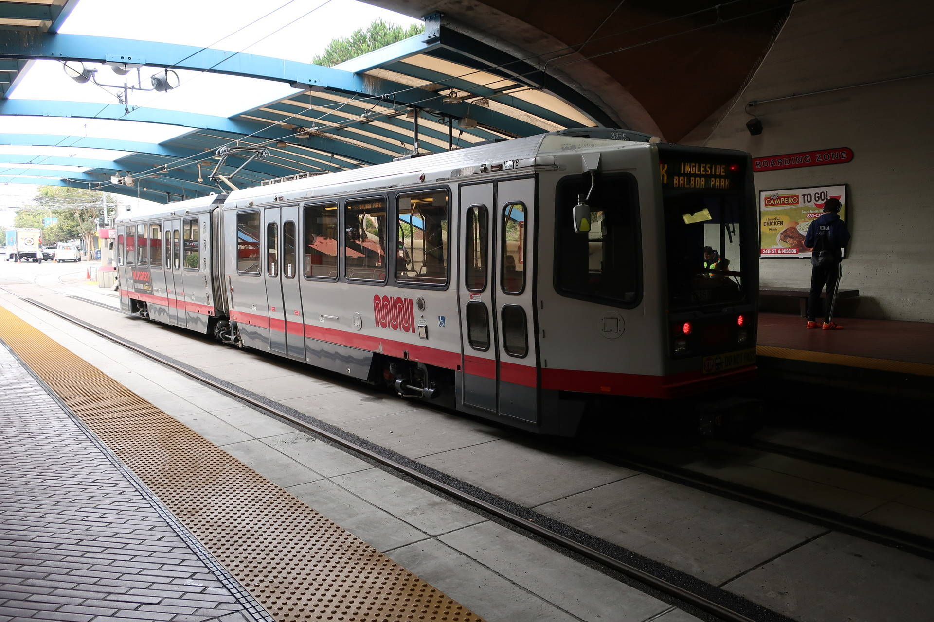 Riders wait to ride Muni at the reopened Twin Peaks Tunnel in San Francisco. Michelle Wiley/KQED