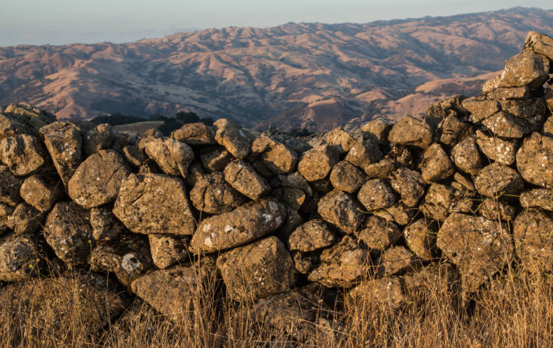 A portion of walls with the Diablo Range in the background.