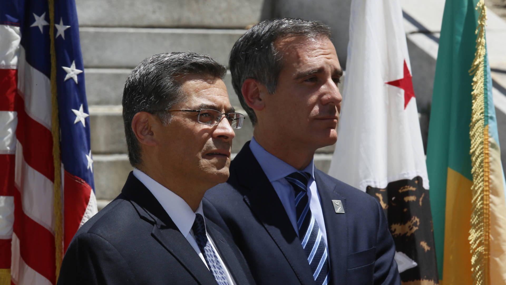 California Attorney General Xavier Becerra (left) and Los Angeles Mayor Eric Garcetti announced the city and county of Los Angeles, plus four other cities, were joining California's lawsuit over the 2020 census citizenship question in May. Damian Dovarganes/AP