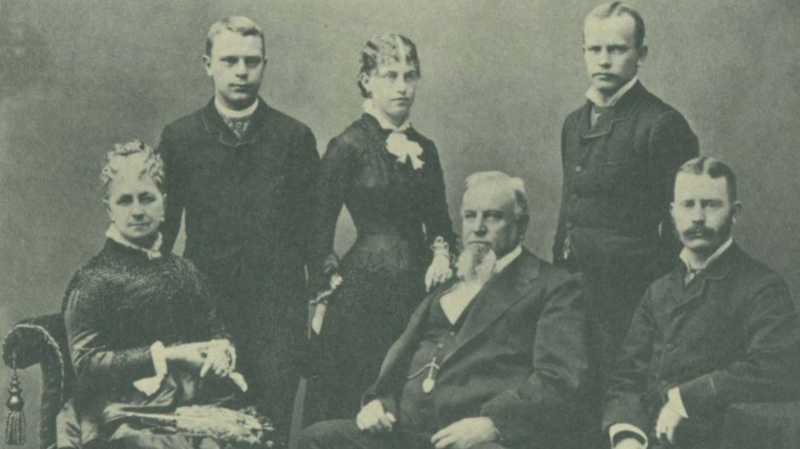 The Crocker family. Harriet Crocker poses in the middle next to her brothers.