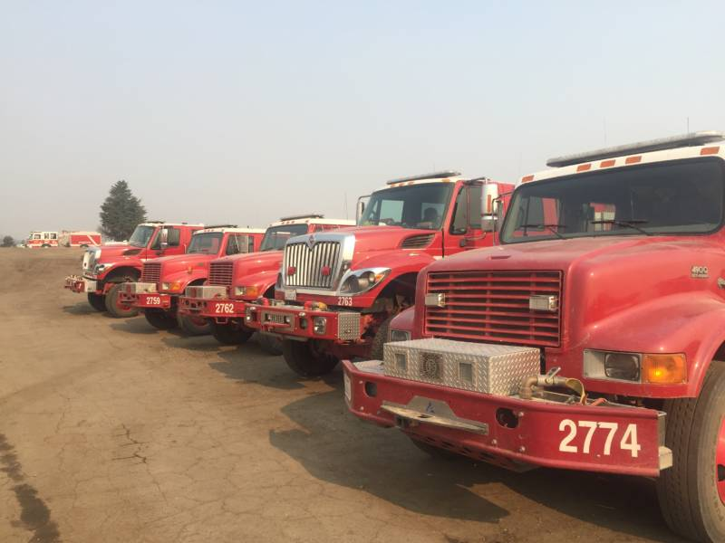 Redding Fire trucks at the incident command center for the Mendocino Complex in Ukiah.