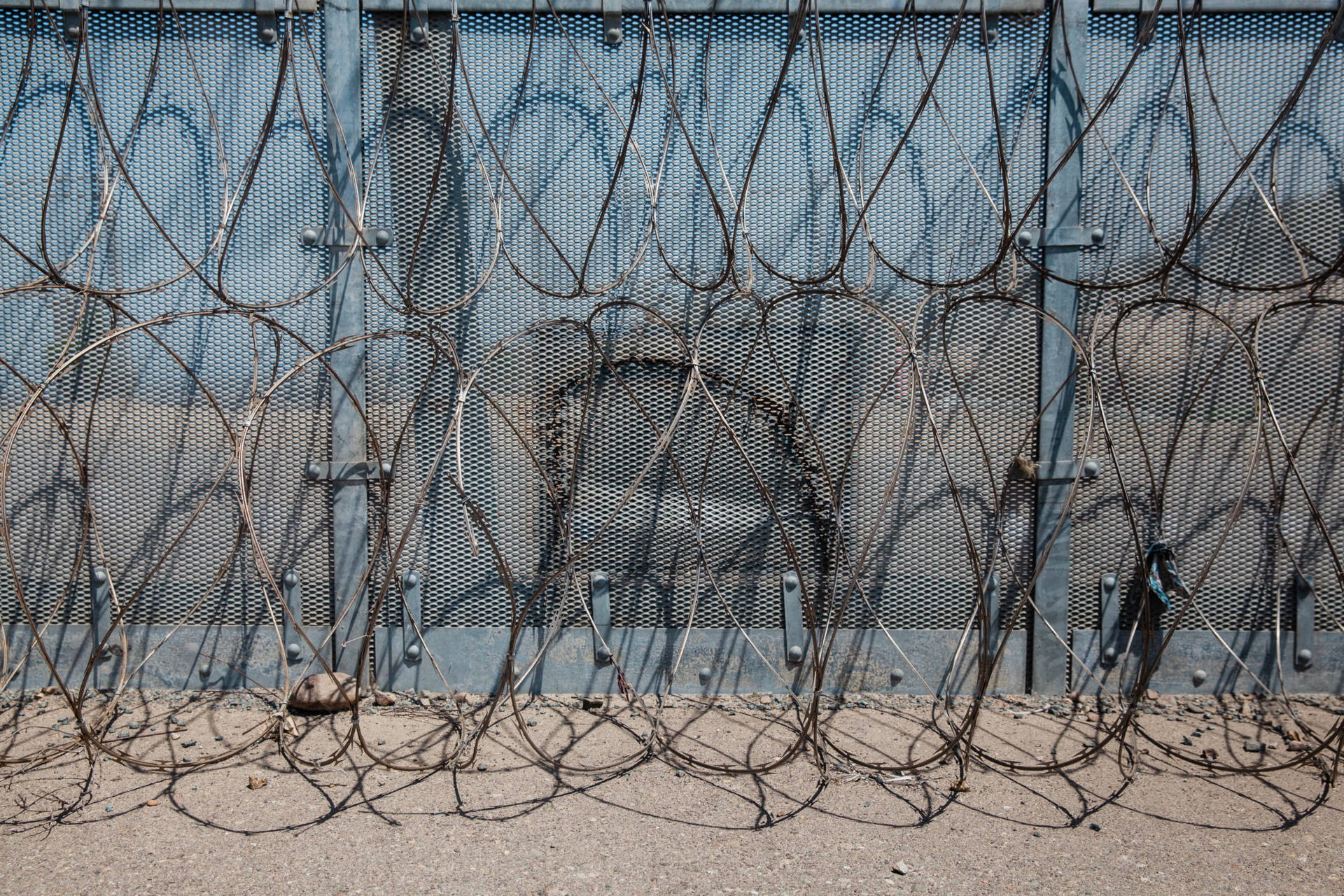 Patchwork of razor wire on the secondary fence south-east of Spooner's Mesa at the San Diego - Tijuana border. The secondary fence gets patched up quite often due to it being cut by people who are trying to go to the United States illegally. (KQED/Drehsler)