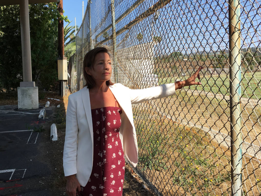 Meghan Flanz is in charge of turning the VA West Los Angeles campus into a community for at least 1,200 chronically homeless veterans. She hopes this former soccer field will be turned into new housing for female veterans and their children.