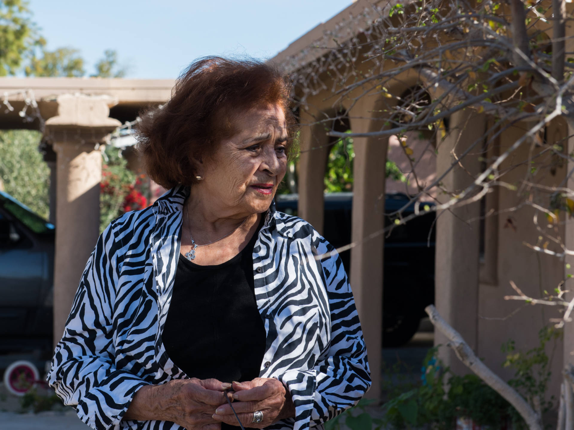 Ramona Morales, 80, was one of many residents facing large fees for a minor code violation. Jessica Chou/NPR