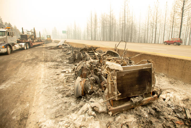 The remnants of a burned-out big rig sit along Interstate 5 during the Delta Fire in the Shasta Trinity National Forest on September 6, 2018.