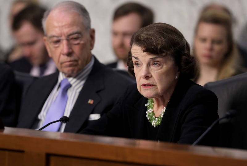 Senate Judiciary Committee ranking member Dianne Feinstein and Chairman Charles Grassley (R-IA) engage in a debate with fellow members of the committee during the third day of Supreme Court nominee Judge Brett Kavanaugh's confirmation hearing.