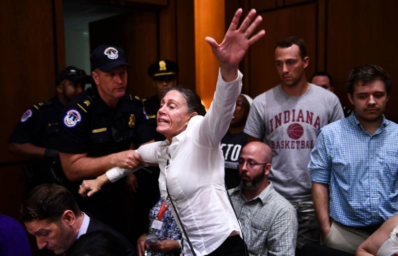 A protester shouts during a hearing of the Senate Judiciary Committee on the nomination of Brett Kavanaugh to the U.S. Supreme Court September 4, 2018.