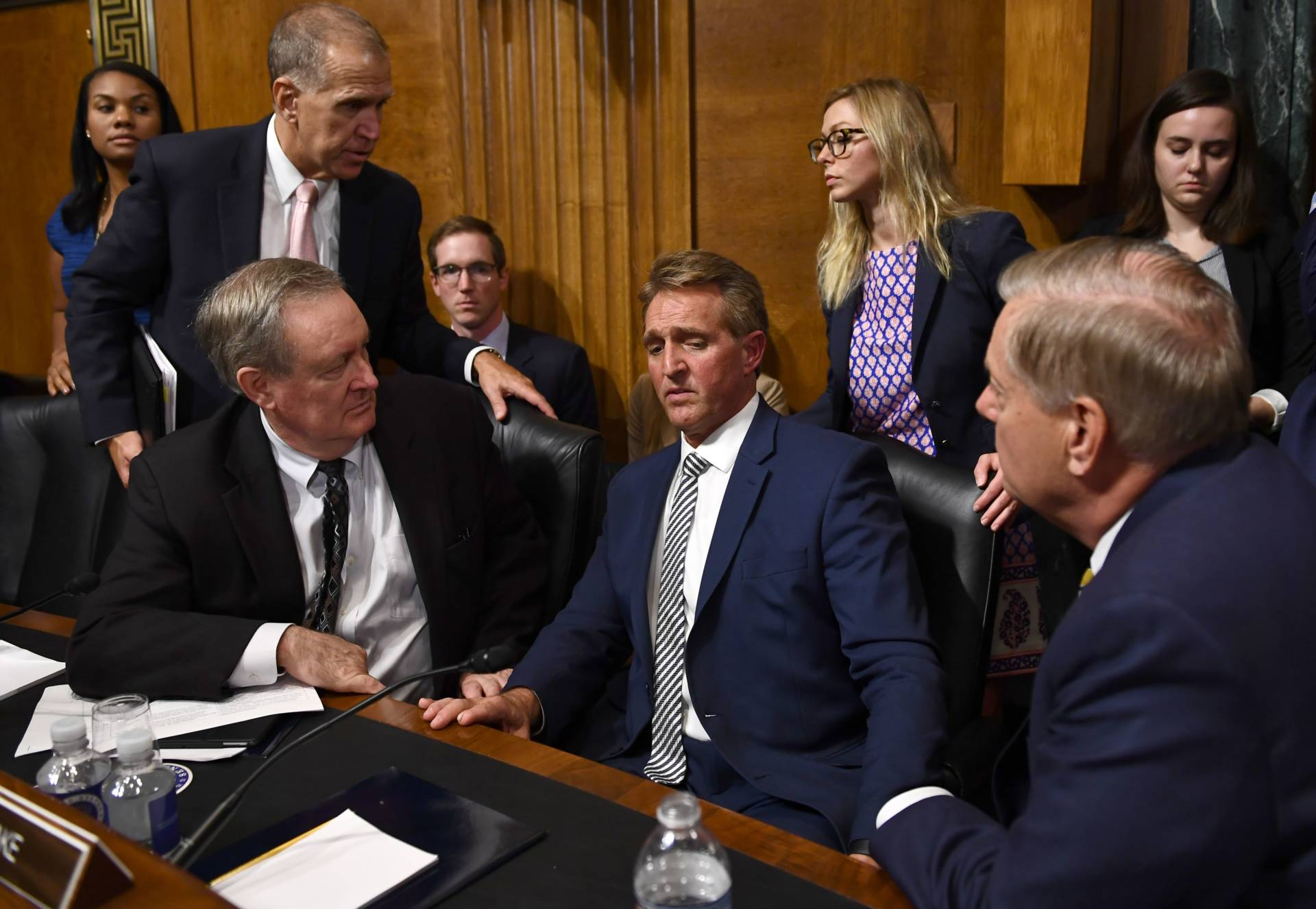 Senate Judiciary Committee member Sen. Jeff Flake (R-AZ) speaks with committee colleagues during a hearing on Capitol Hill in Washington, DC on Sept. 28, 2018 on the nomination of Brett M. Kavanaugh to be an associate justice of the Supreme Court of the United States. Brendan Smialowski/AFP/Getty Images