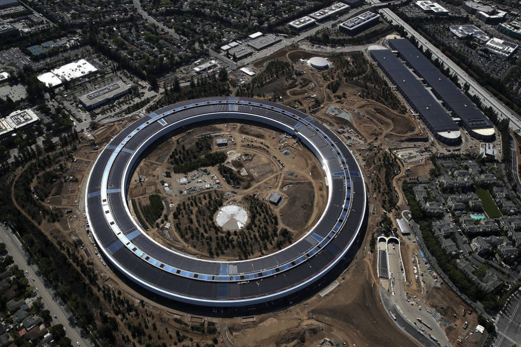 "An aerial view of the new Apple headquarters on April 28, 2017 in Cupertino, California. Apple's new 'spaceship' 175-acre campus dubbed ""Apple Park"" is nearing completion and is set to begin moving in Apple employees. The new headquarters, designed by Lord Norman Foster and costing roughly $5 billion, will house 13,000 employees in over 2.8 million square feet of office space and will have nearly 80 acres of parking to accommodate 11,000 cars."