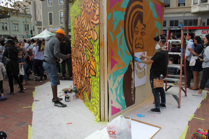 Artists work on their installations at the Oakland Block Party featuring Yo-Yo Ma.