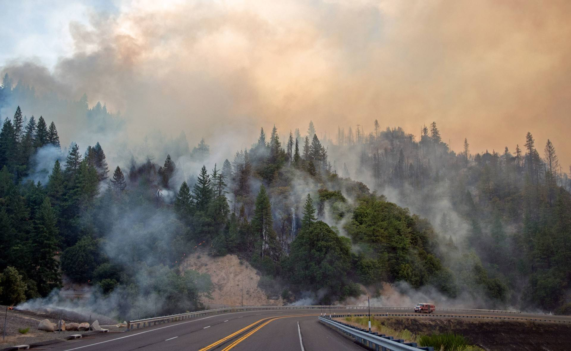 A fire truck drives along Highway 299 as the Carr Fire continues to burn near Whiskeytown, California, on July 28, 2018. JOSH EDELSON/AFP/Getty Images