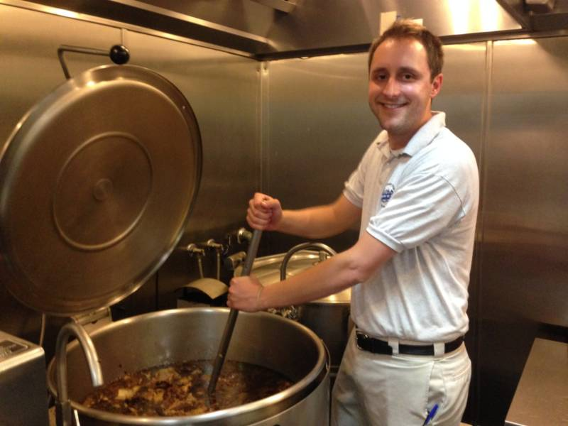 Andrew Binder, fourth generation managing partner of Philippe's restaurant in Los Angeles, stirs 50 gallons of simmering meat that will soon become French dip sandwiches.