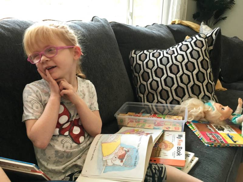 Brooke Adams, 5, who has an intractable form of childhood epilepsy called Dravet Syndrome, reads in her Santa Rosa living room in August 2018.