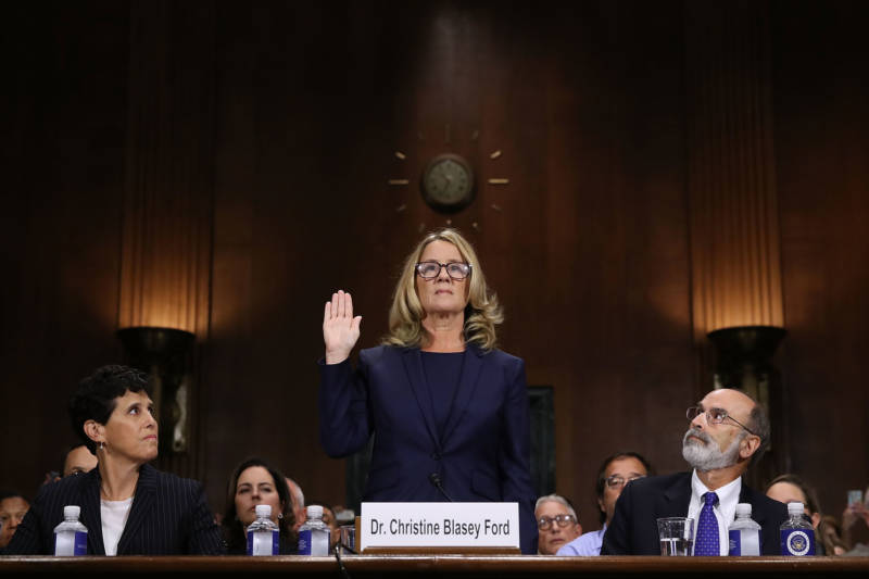 Christine Blasey Ford, the woman accusing Supreme Court nominee Brett Kavanaugh of sexually assaulting her at a party 36 years ago, is sworn in before the Senate Judiciary Committee confirmation hearing on Thursday.