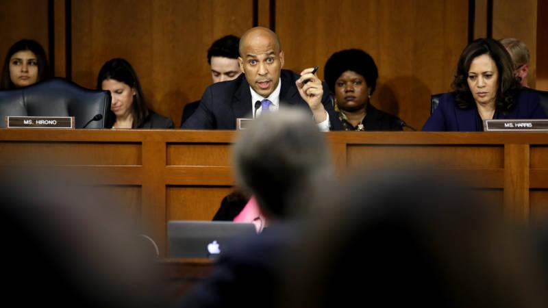 Sen. Cory Booker, D-N.J. — sitting next to Sen. Kamala Harris, D-Calif. — questions Supreme Court nominee Judge Brett Kavanaugh at the Senate Judiciary Committee hearing on Wednesday.