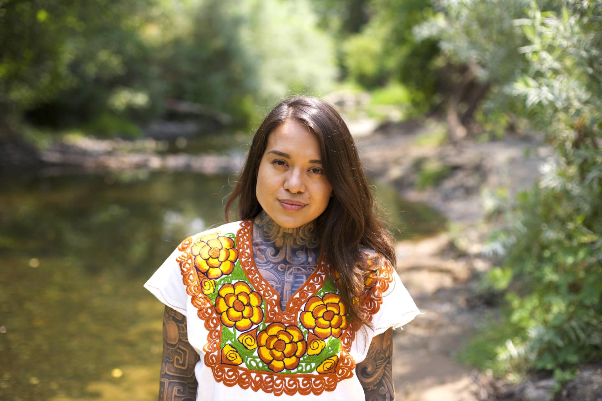 Arleene Correa Valencia stands by the creek on the Silverado Trail in Napa Valley.