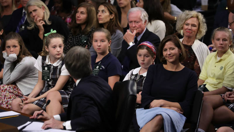 Children who played on sports teams coached by Supreme Court nominee Judge Brett Kavanaugh, along with his wife Ashley Kavanaugh and daughters, 2nd right to left, Lisa and Margaret Kavanaugh, and parents Everett and Martha Kavanaugh, attend the third day of his confirmation hearing before the Senate Judiciary Committee Sept. 6, 2018.