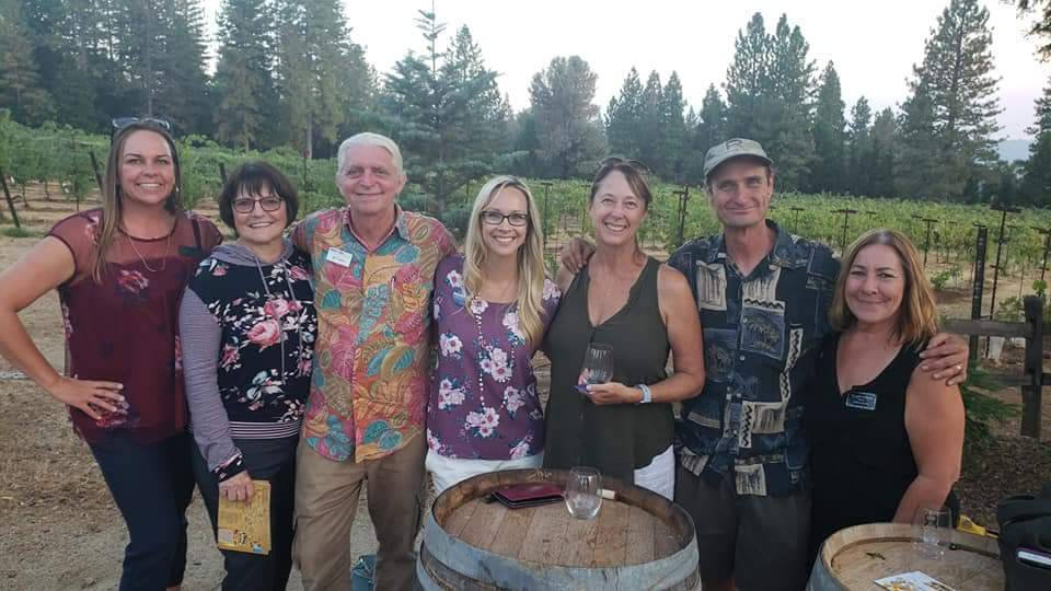 Janelle Horne (center) at the El Dorado Chamber of Commerce mixer in August.