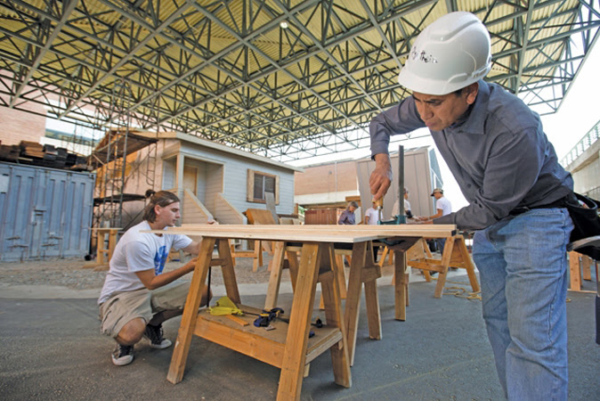 Laney College students work on building a tiny house.