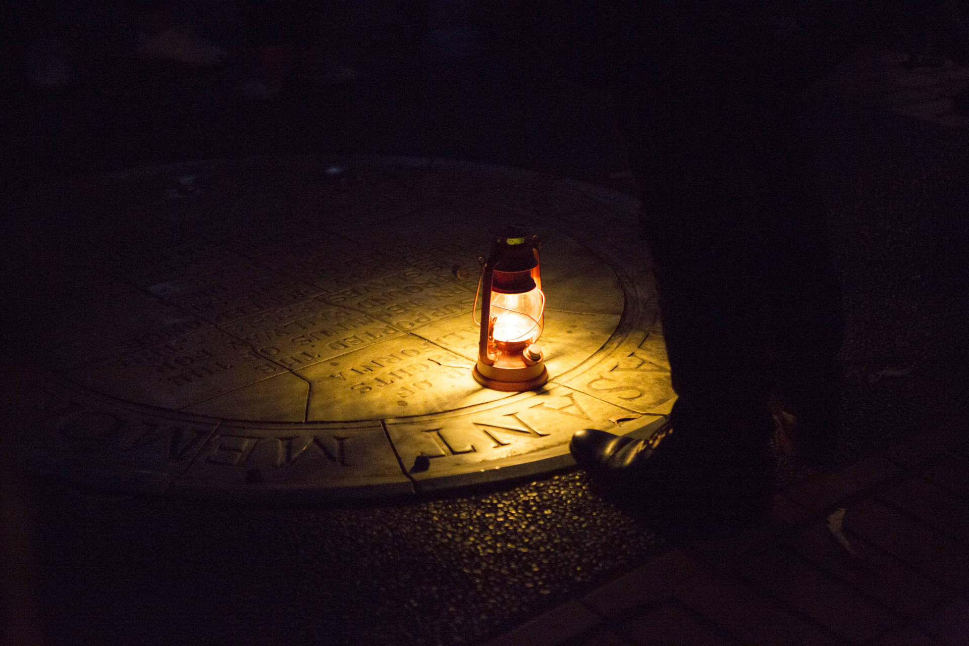 A lantern illuminates the sidewalk plaque dedicated to Mary Ellen Pleasant on the San Francisco Ghost Hunt tour Anne Wernikoff / KQED